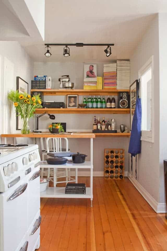 Extra kitchen shelving used to create a desk and storage