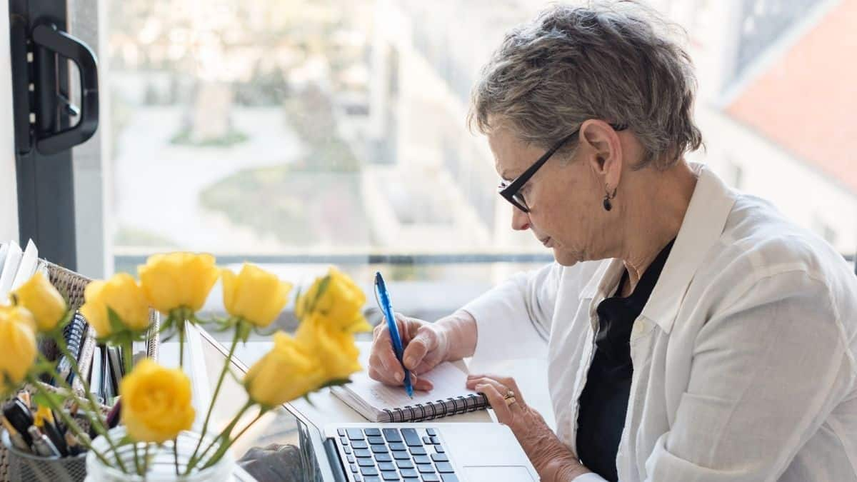 Woman listing her skills from all her previous jobs in preparation for a career change at 50